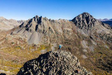 Aerial drone photo - Hiker atop a mountain in the Colorado Rockies.  Sawatch Range