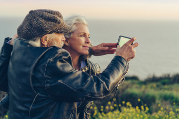 Couple taking selfie on a cellphone at countryside