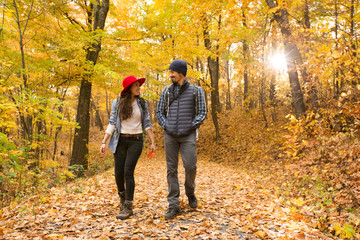 Couple walking on a forest trail during autumn