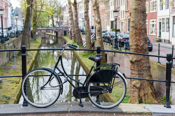 Utrecht. Canal in the center of the city. Bicycles standing on the bridge