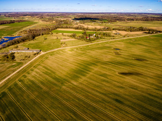 drone image. aerial view of rural area with fields and forests with river and water reflections