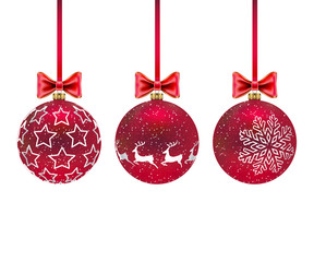 Three Christmas red balls with and bows on white