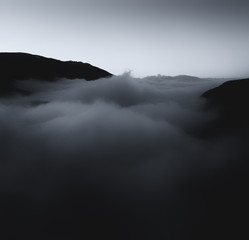 Fototapete - Sunset.  Aerial/Drone photograph of fog/clouds in a mountain valley.  Taken in the Colorado Rocky Mountains