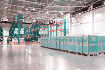 Slightly blurred industrial interior background. Warehouse, storage. Selective focud. Copy space.