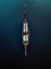 Aerial view of sailing ship in the blue ocean