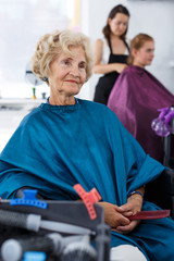 Elderly female client waiting for hair styling