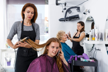 Girl talking on phone in hair salon
