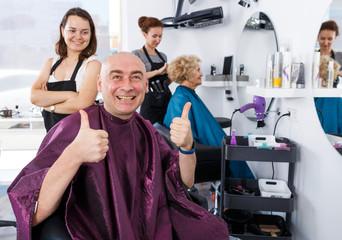 Satisfied man in barbershop