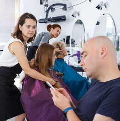 Teenage girl with father in hair salon