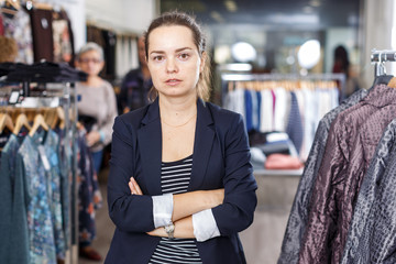 Woman in black jacket  in clothing shop