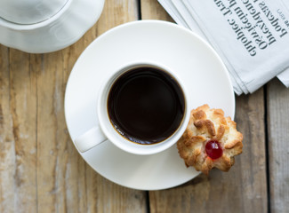 Sweet homemade cookies and cup of coffee on the table, selective focus and copy space, flat lay