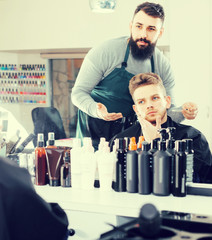 client feeling discontent about his new haircut at hair salon