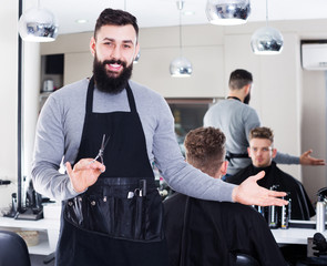 Hairdresser demonstrating his workplace