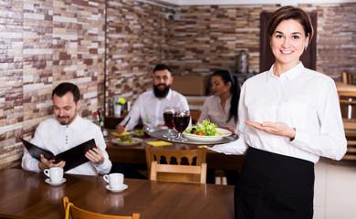 Female waiter showing country restaurant