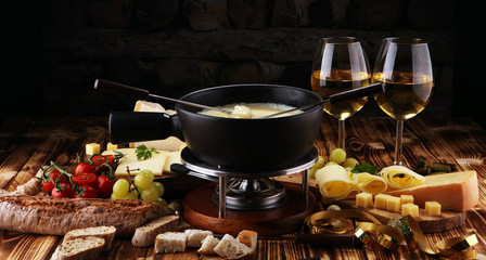 Gourmet Swiss fondue dinner on a winter evening with assorted cheese