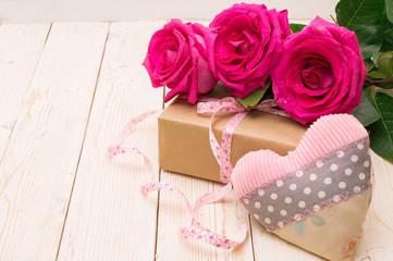 beautiful roses with gift box. happy mothers day, romantic still life, fresh flowers.