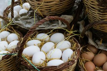Fresh eggs in baskets