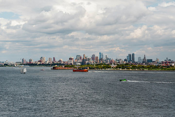 New York City / USA - AUG 22 2018:  Governors Island and skyscraper of Brooklyn downtown view from the Statue of Liberty