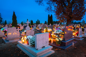 Colorful candles on the cemetery at All Saints Day, Poland Wall mural