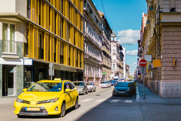 Yellow car parked on the street