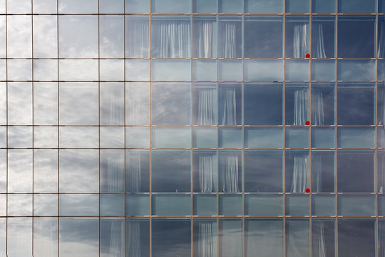 Glass office or residential building in sunlight.