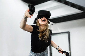 Blond girl playing VR game