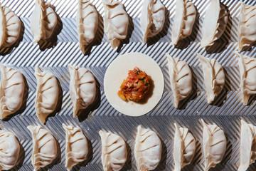 Fresh dumplings on purple background