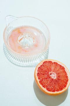 Juicer with grapefruit half