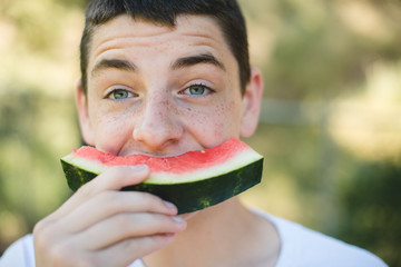 Silly Teen eating watermelon