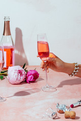Hand of woman holding rose champagne