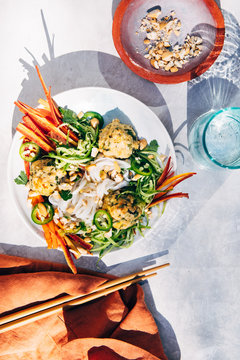 Thai chicken meatballs, rice noodles and vegetables