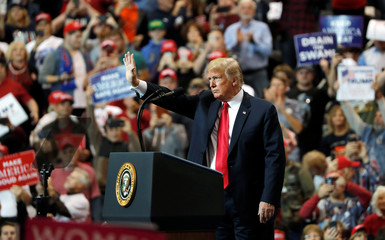 U.S. President Trump waves during a campaign rally in Cleveland, Ohio
