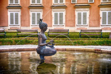 Water fountain with statue of a girl in Mirabell palace gardens Salzburg, Austria