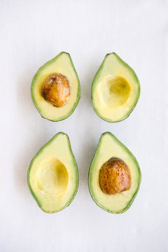 Two sliced avocados