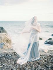 Feminine model in light dress