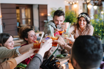 Positive friends with cocktails