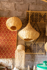 Wicker items and tapestry on display