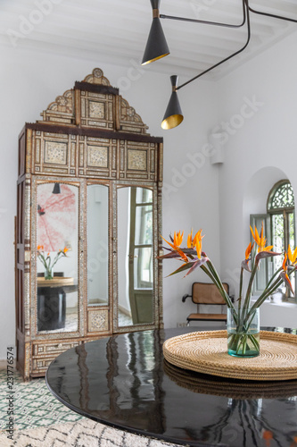 An armoire and table in a dining room\