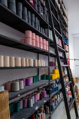 Spools of thread on a shelf