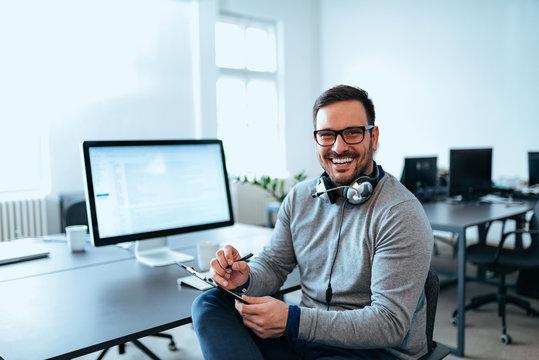 Portrait of a software developer working at modern office.