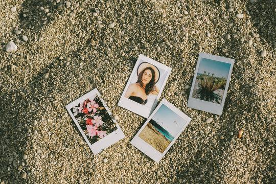 Summer Themed Polariods On The Beach Sand