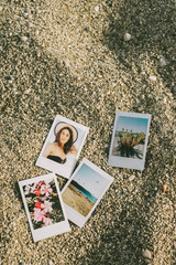 Summer Themed Polariods On The Beach Sand
