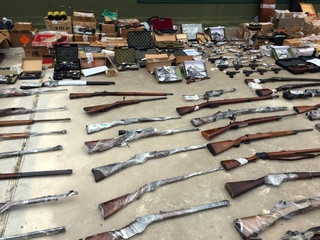 Weapons and ammunition seized by Argentine authorities in a container  coming from the U.S. are displayed in Buenos Aires