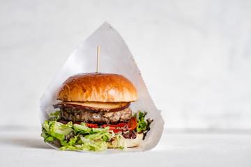 Fototapeta Tasty burger on isolated background. obraz