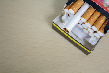 Cigarettes in box. Top view with copy space