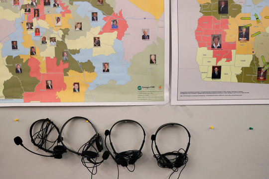 Maps of Georgia, split into house of representatives districts, can be seen with headphones for phone banking at Republican gubernatorial candidate Brian Kemp's campaign office during a phone banking event in Atlanta, Georgia, U.S.