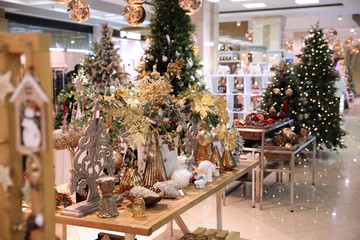 Very beautiful sparkling room with Christmas Souvenirs, gifts on the background of Christmas trees