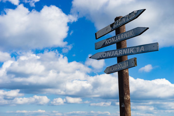 blank signpost on background of blue sky