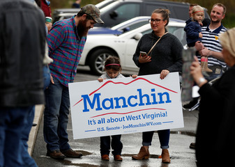 Senator Joe Manchin (D-WV) greets supporters at a campaign stop ahead of the 2018 midterm elections in Bridgeport, West Virginia