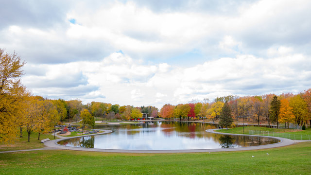 Beaver lake at the top of Mont-Royal, as foliage bursts with autumn colors. Montreal, Canada